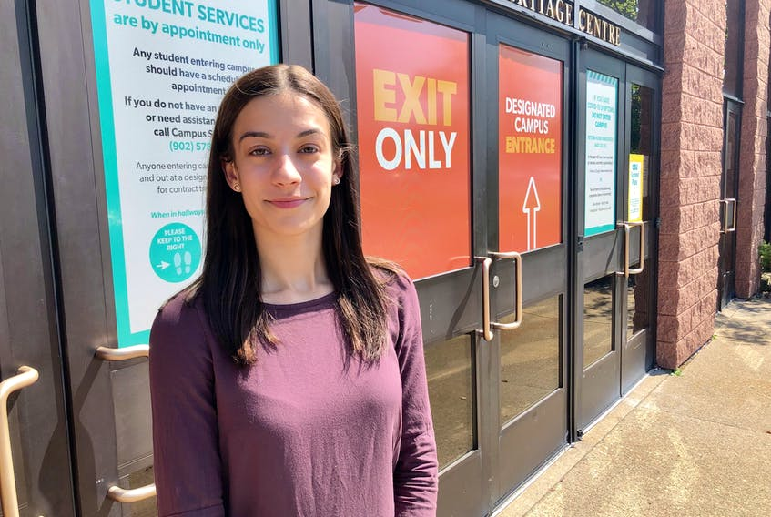 Cape Breton University Students' Union President Madlyn O'Brien stands outside the one of the school's entrances on Thursday, less than two weeks before the CBU opens for in person classes — part of level four of the university's Return to Campus plan. NICOLE SULLIVAN/CAPE BRETON POST