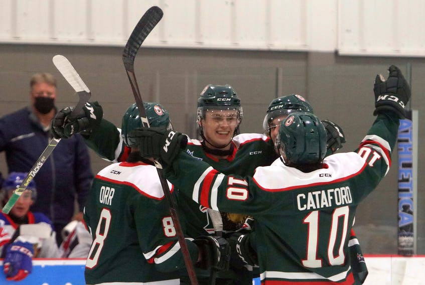 The Mooseheads jubilate after scoring seven minutes in the first against the visiting Moncton Wildcats at the RBC Centre Friday.