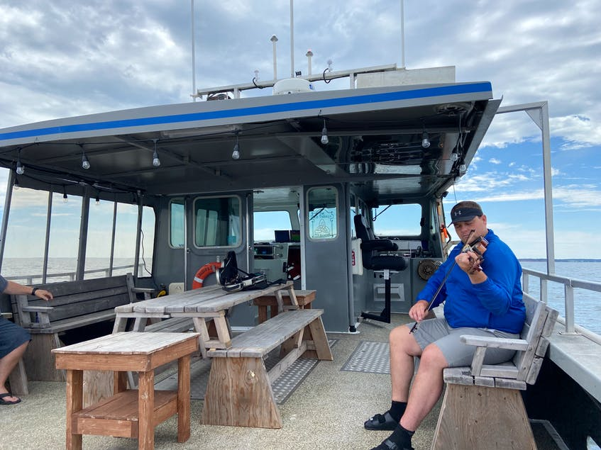 Emma MacKinnon says her summer travel highlights have included a trip out to sea with JJ Chiasson from the Fiddling Fisherman. - Photo Contributed.