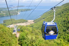 Looking down from inside of one of the eight-person cars that transport passengers to the top of the Destination Cape Breton resort. DAVID JALA/CAPE BRETON POST
