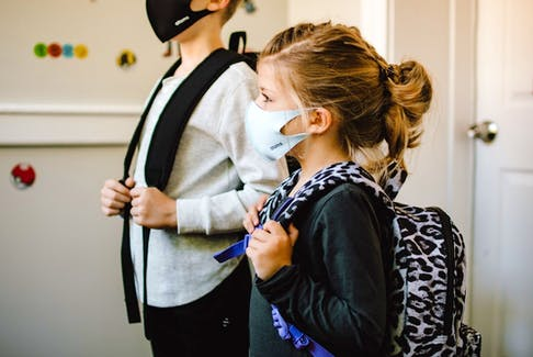 The P.E.I. government will require staff and students to wear masks once schools reopen in the fall.