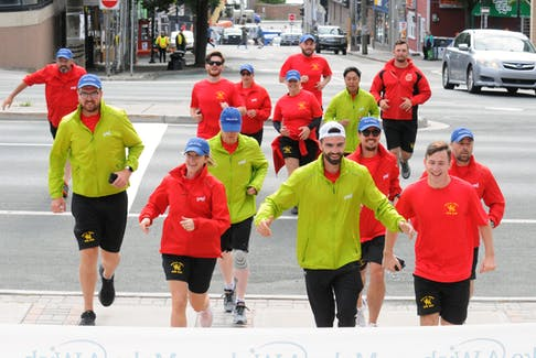 Crew members from HMCS St. John's run for the steps of St. John's City Hall Friday morning as they ended the 25th annual Run The Rock. The event raises money for the Newfoundland and Labrador branch of Make-a-Wish Canada (Children's Wish Foundation). -Joe Gibbons/The Telegram