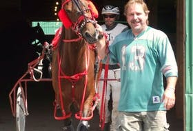 Broadway Bill, with owner Jamie Hogan. The 16-year-old standardbred escaped from its stall early Saturday, but Cape Breton Regional Police were able to locate him and lead it back to its rightful owner, Hogan. — CONTRIBUTED