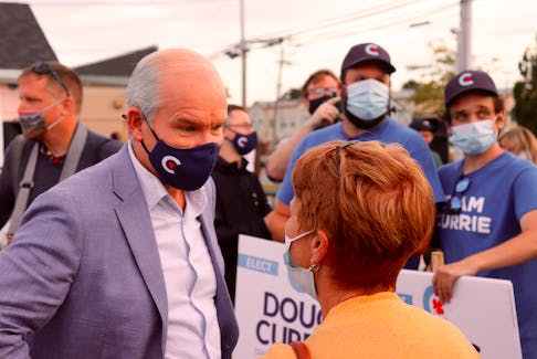 Conservative Party of Canada leader Erin O'Toole speaks with a supporter at a 2021 campaign stop in Charlottetown on August 28.