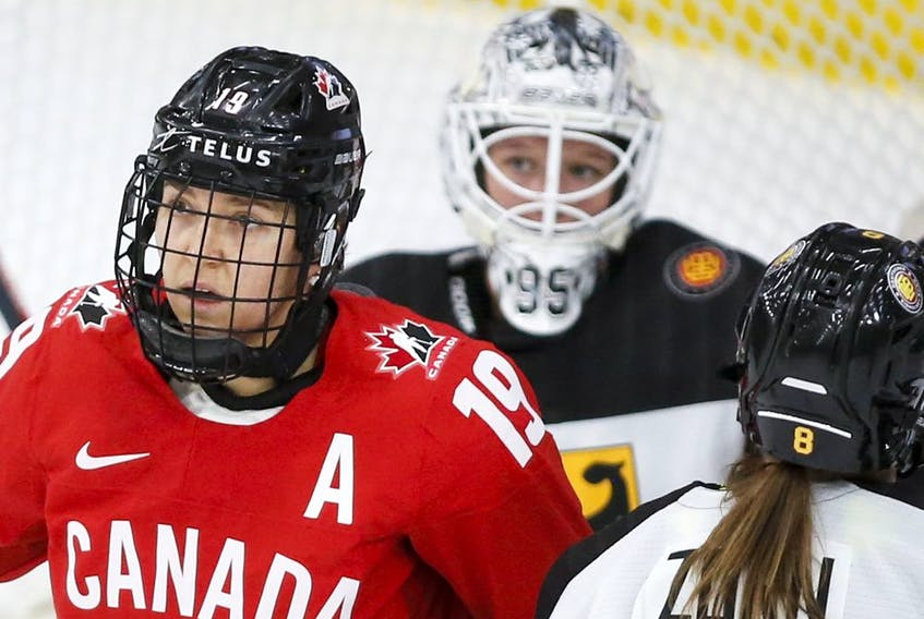 Canada's Brianne Jenner, left, celebrates her goal as German goalie Franziska Albl looks on during first-period quarterfinal action at the IIHF Women's World Championship hockey in Calgary on Saturday.