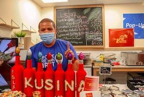 Julius Garcio, co-owner of Isla Kusina Bar & Restaurant in Sydney, a the Pop-Up Bistro at the Cape Breton Farmers' Market on Saturday. JESSICA SMITH/CAPE BRETON POST