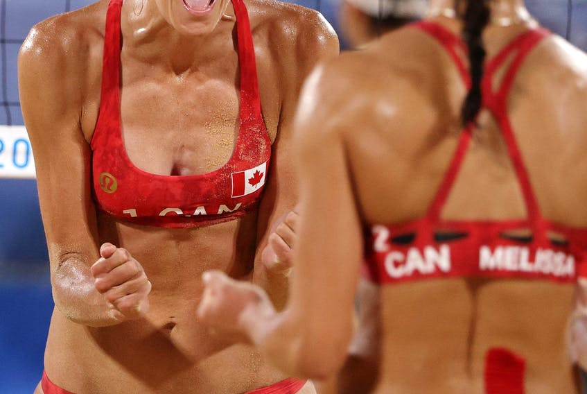 Sarah Pavan #1 and Melissa Humana-Paredes #2 of Team Canada react as they compete against Team Australia during the Women's Quarterfinal beach volleyball on day eleven of the Tokyo 2020 Olympic Games at Shiokaze Park on August 03, 2021 in Tokyo, Japan. (Photo by Ezra Shaw/Getty Images)