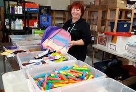 Wanda Earhart stands in the Every Woman's Centre in Sydney near their school supply donations, which they donate to students in need from primary to post-secondary school.