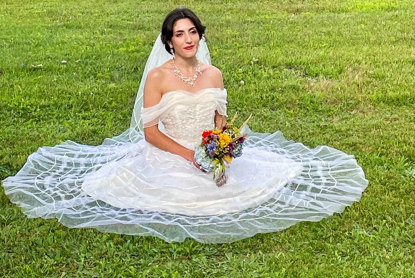 On her wedding day, Jillian Clow of Kensington wore the same dress worn by her aunt, Dawna Woodside, and grandmother, Caryl Cummings.