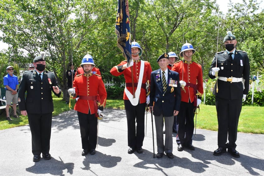 Second World War veteran Charlie Muise, on his 100th birthday, standing with members of the Princess Louise Fusiliers – his regiment from the Second World War. Member traveled from Halifax to Tusket, Yarmouth County, to help Muise mark his birthday milestone. TINA COMEAU PHOTO