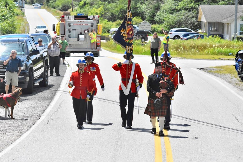 Marching towards Charlie Muise's house. TINA COMEAU PHOTO