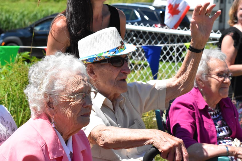 Charlie Muise waves to the participants of a surprise birthday parade in his honour on Aug. 1. TINA COMEAU PHOTO