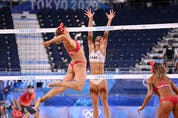 Canada's Heather Bansley (L) attempts a shot past Latvia's Tina Graudina in their women's beach volleyball quarter-final match between Latvia and Canada during the Tokyo 2020 Olympic Games at Shiokaze Park in Tokyo on August 3, 2021. (Photo by Daniel LEAL-OLIVAS / AFP) (Photo by DANIEL LEAL-OLIVAS/AFP via Getty Images)