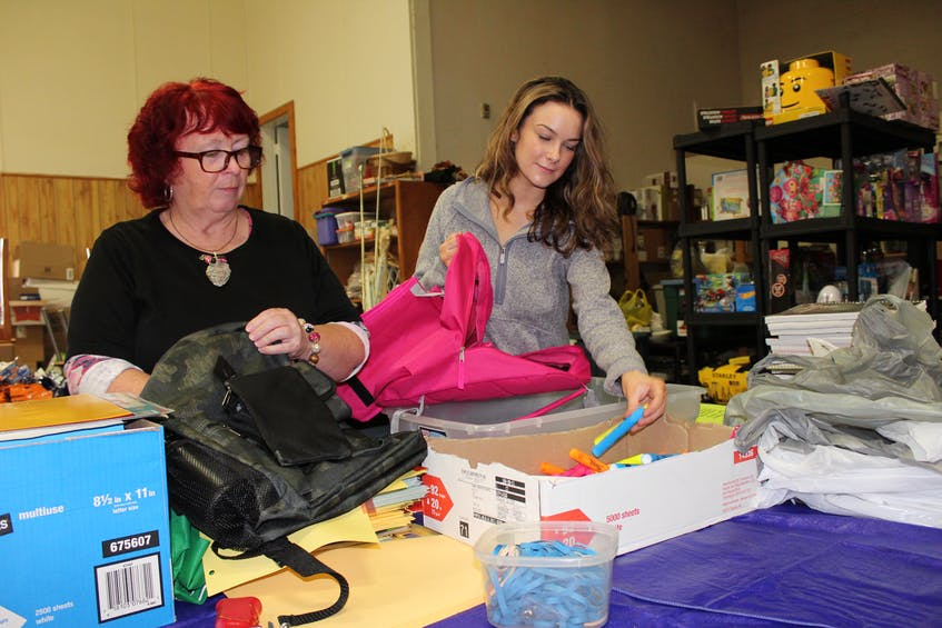 In this file photo from 2019, Wanda Earhart, left, and Bhreagh Unsworth sort some of the donations that have been received at the Every Woman's Centre for its annual back to school program. It is an income-based program that helps provide up to 400-500 children annually with some of the supplies they require when heading back to school. CAPE BRETON POST FILE