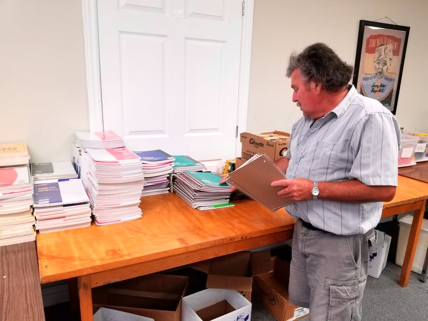 In this file photo from 2019, New Waterford Kinsman Andrew Digero stands in front of a table filled with school supplies that will eventually find homes in the desks and lockers of kids returning to school in September. CAPE BRETON POST FILE