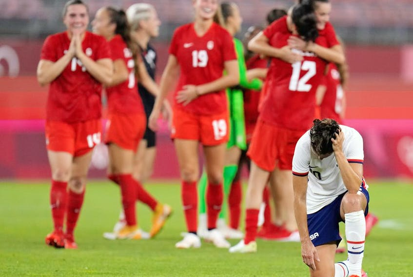 United States' Carli Lloyd reacts after being defeated 1-0 by Canada during a women's semifinal soccer match at the 2020 Summer Olympics.