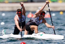 Dartmouth's Connor Fitzpatrick, right competes in the Olympic men's C2 2000 with Roland Varga at the Sea Forest Waterway in Toyko on Monday. - Olympics Canada