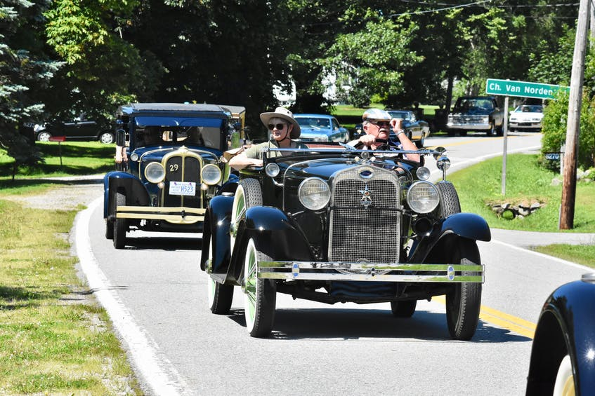 The surprise birthday parade makes its way through Tusket, Yarmouth County, to wish veteran Charlie Muise a happy 100th birthday. TINA COMEAU • TRICOUNTY VANGUARD
