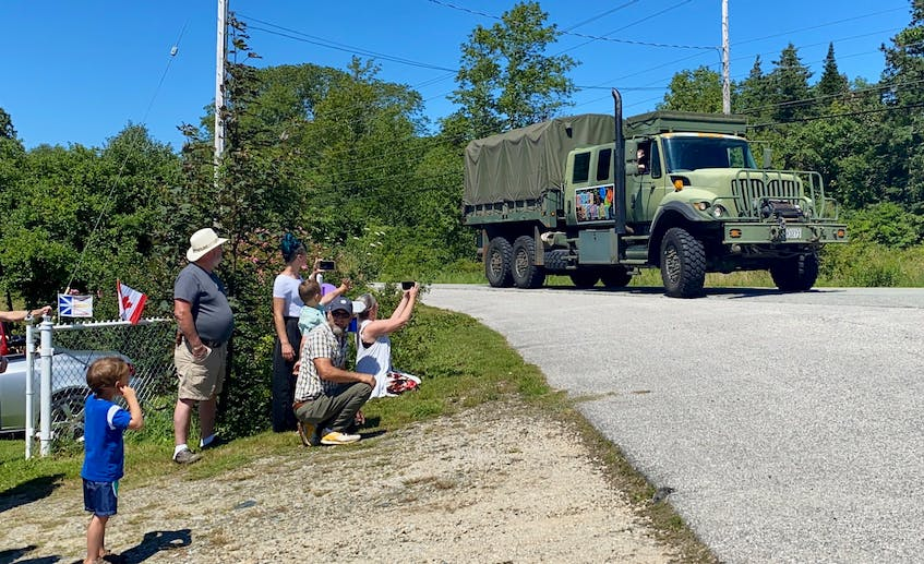 A military vehicle was part of the surprise parade for Second World War veteran Charlie Muise. TINA COMEAU • TRICOUNTY VANGUARD