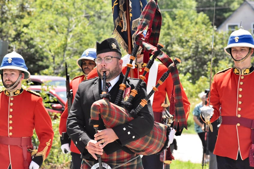 Yarmouth bagpiper Joe Bishara leads members of the Princess Louise Fusiliers as they march to the home of Second World War Charlie Muise to help him celebrate his 100th birthday. TINA COMEAU • TRICOUNTY VANGUARD