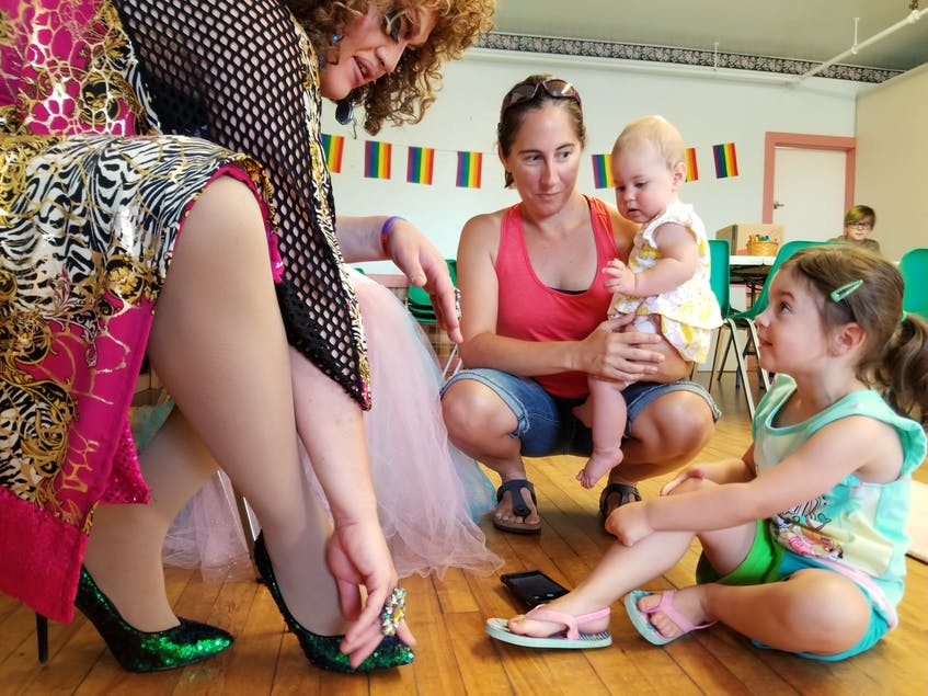 Halifax-based drag queen Miranda Wrights compares shoes with children during a Drag Queen Storytime hosted by the Glace Bay Library in 2019. FILE PHOTO/CAPE BRETON POST