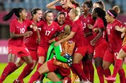 Canada's players celebrate winning 4-3 in a penalty shootout against Brazil during a women's quarterfinal soccer match.