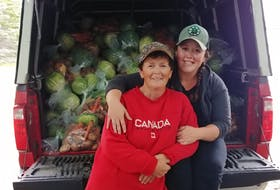 Karen Durfey of Markland, NL, left, continues the family business, Ripple Trail Farm, with her daughter Kayla. Durfey started farming in 1998 when she returned home to work with her father, Bernard Tucker.