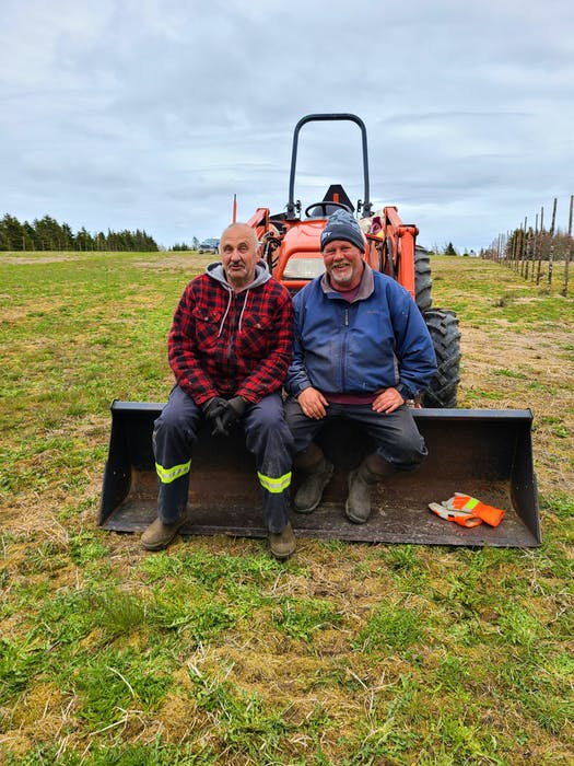 Family friend Obie and Dennis Durfey take a break after a day of putting up fences at Ripple Trail Farm.