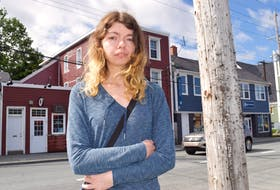 Hailey O'Day of Sydney stands outside her third-floor apartment on Townsend Street in Sydney, where she says she has been living for about 11 months in an unsafe, mouse-infested apartment. O'Day says there's a huge housing issue in the Cape Breton Regional Municipality and she can't find anywhere else to go. Sharon Montgomery-Dupe/Cape Breton Post