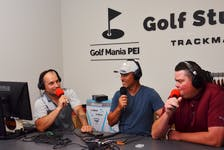 From left, co-hosts Nick Frid, Len Currie and Ben King discuss a topic during the Island Green Podcast, presented by Golf Mania P.E.I. The trio recently recorded Episode No. 25 of the podcast, which is growing in popularity.