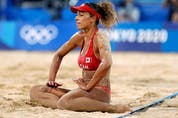Brandie Wilkerson of Canada on the ground during her quarter-final match. REUTERS/Pilar Olivares