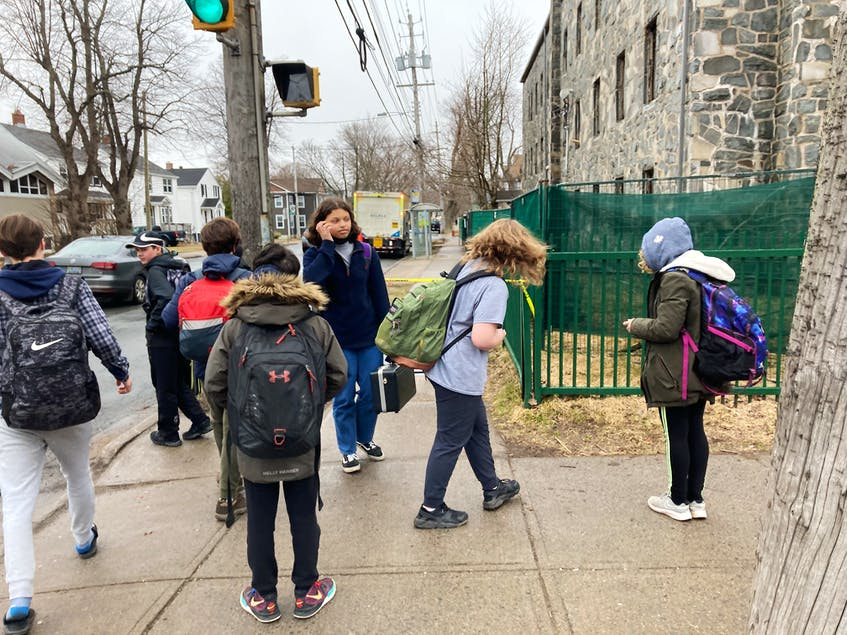 Students from Oxford Primary to Grade 9 school discover that Oxford Street sidewalk and the bus stops adjacent bus stops are closed. - Andrew Rankin