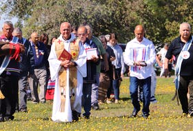 The burial ceremony proceeded after a blended Mi'kmaw-Catholic mass at St. Bonaventure's Parish.