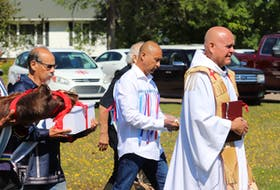 Mi'kmaq elders and Father Gerard Chaisson deliver remains of five Prince Edward Island Mi'kmaq to a cemetery outside St. Bonaventure's Parish on Aug. 29. The remains had been taken to Memorial University in 1959.