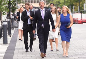 Tim Houston and his family - wife Carol, and children Zachary and Paget - arrive at the Halifax Convention Centre on Tuesday, Aug. 31, 2021, where he will be sworn in as Nova Scotia's new premier, along with other members of his first cabinet.