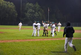 The Capital District Islanders congratulate each other after an exciting 4-3 win over the Summerside Toombs and MacDougall CPA Chevys on Aug. 30. The best-of-five final series in the Island Junior 22-Under Baseball League is tied 2-2. The fifth and deciding game is at Queen Elizabeth Park's Legends Field in Summerside on Sept. 2 at 8 p.m.