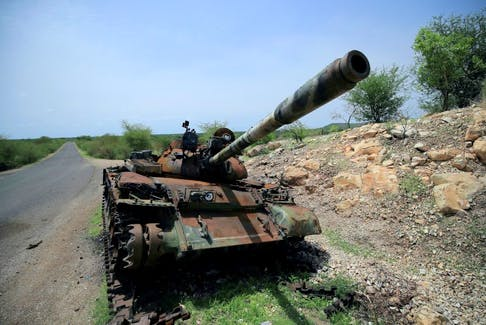 A tank, damaged during the fighting between Ethiopia's National Defense Force (ENDF) and Tigray Special Forces, stands on the outskirts of Humera town in Ethiopia. REUTERS/Stringer/File Photo