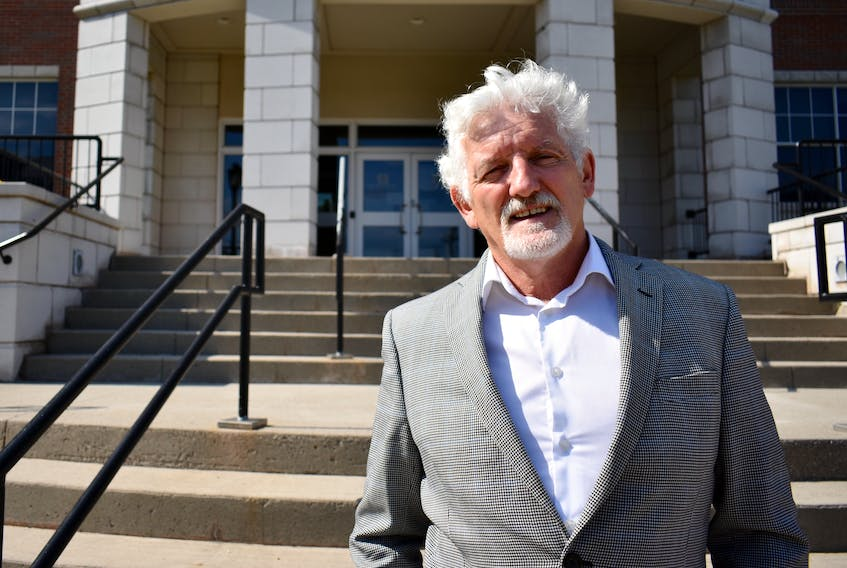 Sandy MacDonald, president of Holland College, stands outside the Centre for Applied Science and Technology building on the Charlottetown campus in this file photo. MacDonald says not having a sports field for student athletes is difficult, especially when they need to travel for daily practice.