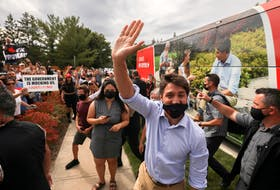 Prime Minister Justin Trudeau waves during his election campaign tour in Nobleton, Ont., on Aug. 27. REUTERS/Carlos Osorio