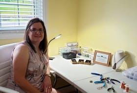 Linda Barnes creates jewelry using sea glass and gemstones at her Lantz home.