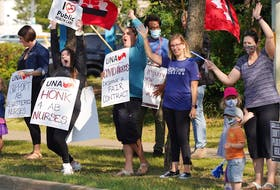 About 100 nurses and supporters staged a protest rally outside the Sturgeon Community Hospital in St. Albert on Monday, July 26, 2021, to protest proposed wage rollbacks and other changes in a new collective agreement.