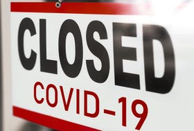 Closed due to COVID sign.