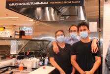 Harsha Deshpande operates Flavours Indian Cuisine with help from her husband, Akhil (centre), and their two sons, including Harshal. Missing from the photo is their other son, Deepal.