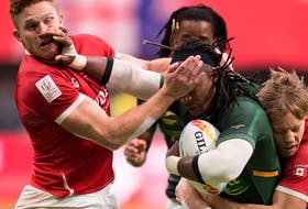 Canada's Connor Braid, left, and Harry Jones, right, tackle South Africa's Branco du Preez during the bronze medal match at the Canada Sevens rugby tournament in Vancouver March 8, 2020. The event is expected to return this fall.