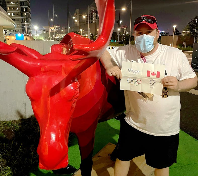 Shelburne County native Josh Goreham, who is a Performance Technologist with the Canadian Olympic Committee, poses beside the Canadian moose mascot at the Tokyo Games. Contributed - Contributed