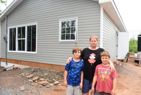 Elaine Heighton, shown with sons Chesney and Ryker, is hoping her family will be able to move into their new Tatamagouche home within the next few weeks.