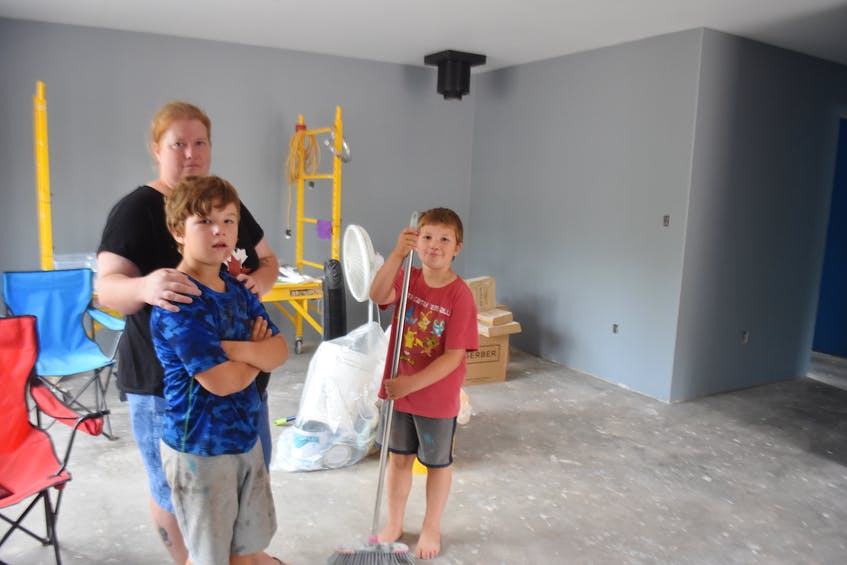 Elaine Heighton with sons Chesney and Ryker inside what will soon become their new home.  - Harry Sullivan