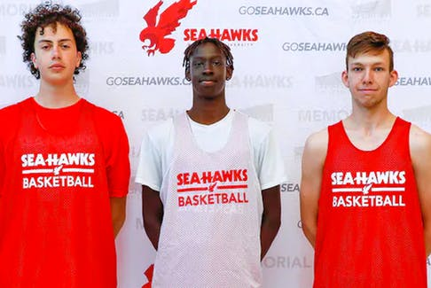 These three former St. John's high school basketball stars are among the latest recruits for the MUN men's basketball team. Shown (from left) are Nicholas Edwards from Waterford Valley, Liai Tong from Holy Heart of Mary and Nathan Childs from  Gonzaga have all committed to the Memorial program. — Contributed