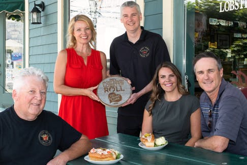 Left to right: Shane Campbell, owner of Water Prince, Melody Dover, president of Fresh Media, Coady Campbell, manager of Water Prince, Charlotte Campbell, marketing director of Lobster P.E.I., minister Jamie Fox, Dept. Fisheries and Communities.