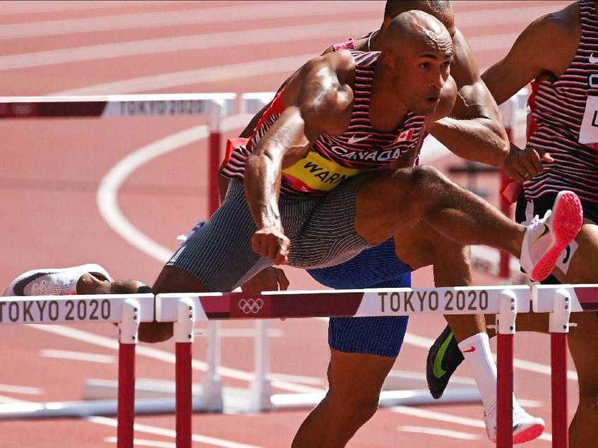 Canada's Damian Warner competes in the men's decathlon 110m hurdles during the Tokyo 2020 Olympic Games at the Olympic Stadium in Tokyo on August 5, 2021. (Photo by Ina FASSBENDER / AFP) - INA  FASSBENDER